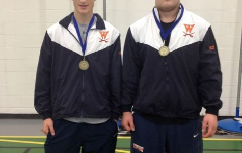 Two Walpole Wrestlers pose after winning the Jeff Parker Memorial Tournament.