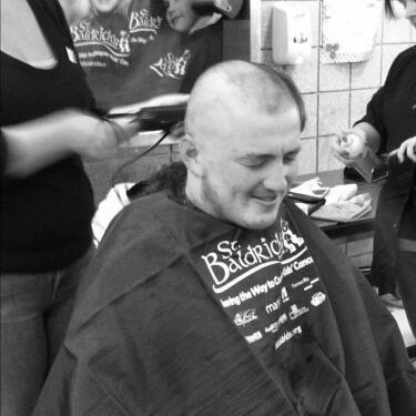 Walpole football player gets his head shaved