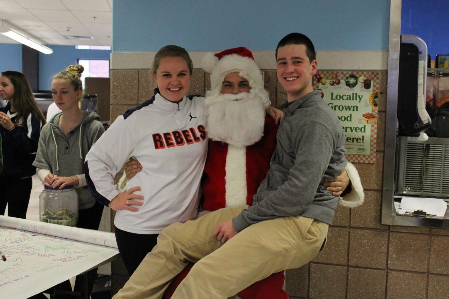Students pose with Santa during lunch.