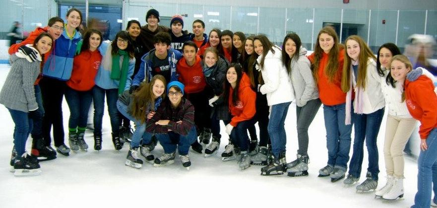 The Exchange students pose for a photo at a skating rink.