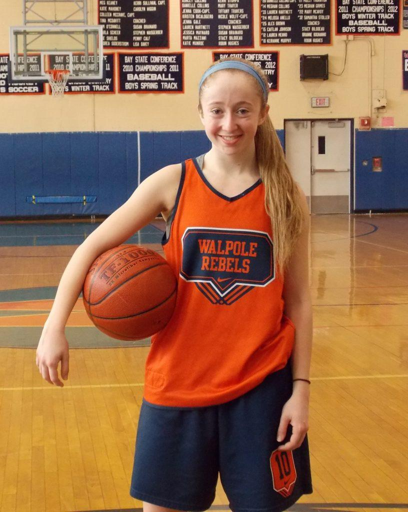 A Walpole girls basketball player poses for a photo.