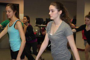 Caitlin teaches some new choreography to the company