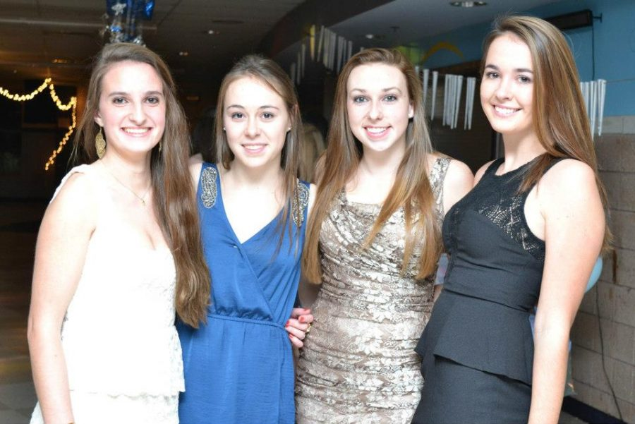 Students smile for a picture at the second annual Winter Ball.