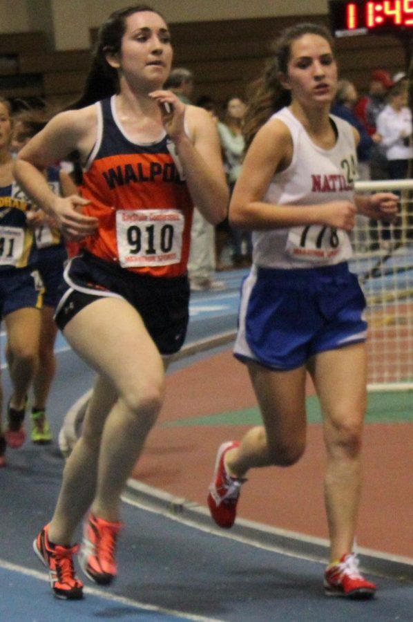 Walpole runner holds onto Natick runner throughout the race (Photo/Danielle Levya).