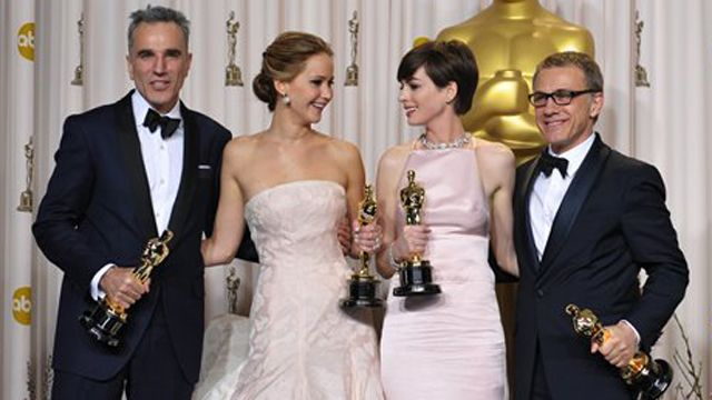 Daniel Day-Lewis, Jennifer Lawrence, Anne Hathaway, and Christoph Waltz show off their Oscars.