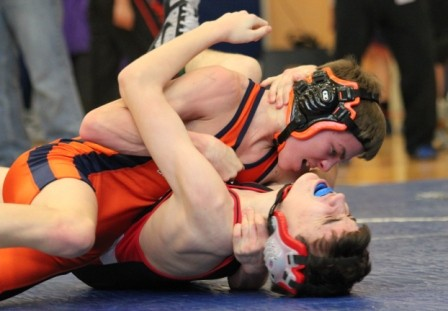 The Rebel's 106 pounder works to pin his opponent.