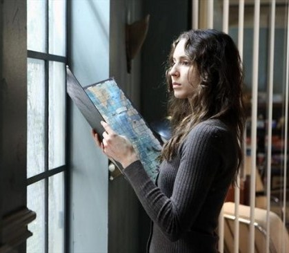 Spencer follows clues that Mona wrote on a game board.