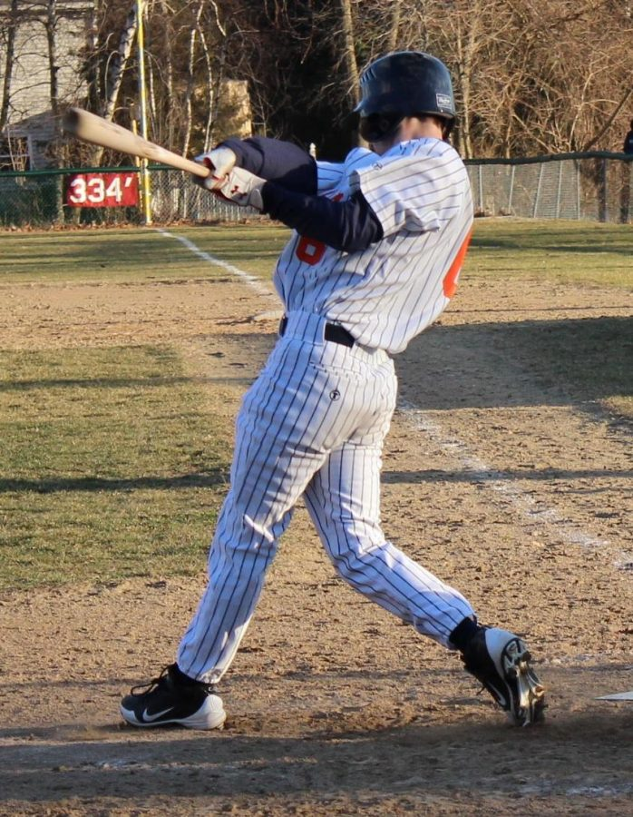 Walpole infielder makes contact against Natick.