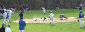 Senior Outfielder slides into home safely for a grand slam.