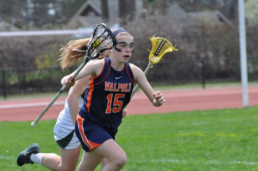 A Walpole player looks to transition into offense after picking up a ground ball.(Photo/ Mary Barry)