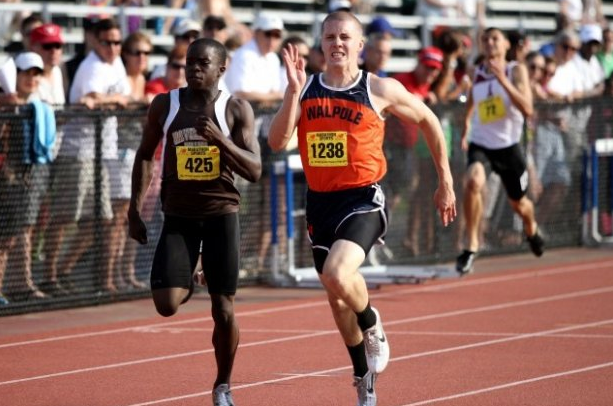 A Walpole runner wins the 200 meter dash at the All State Championship.