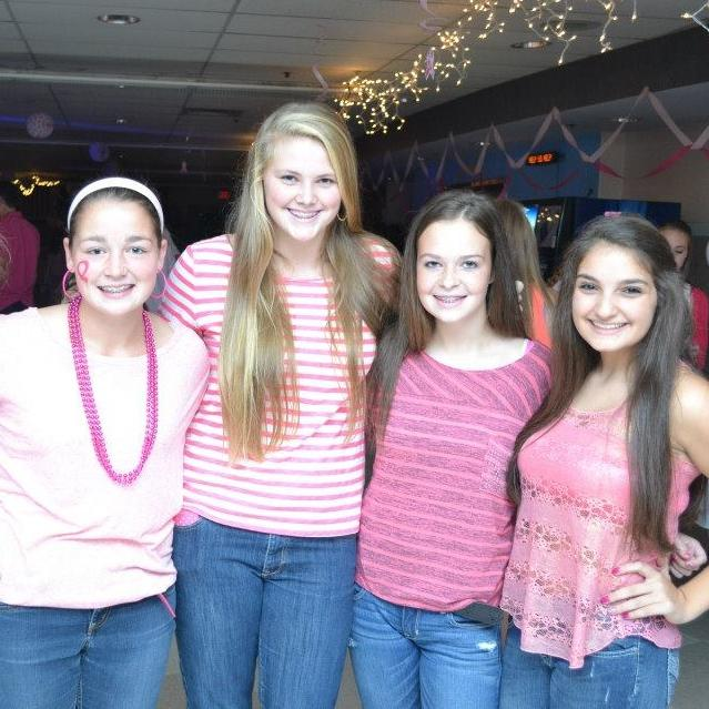 Students at last year's dance dressed in pink.