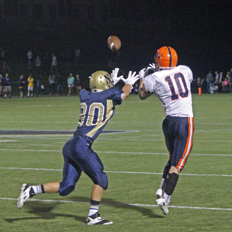 A senior wide reciever goes to make the catch in a previous game.