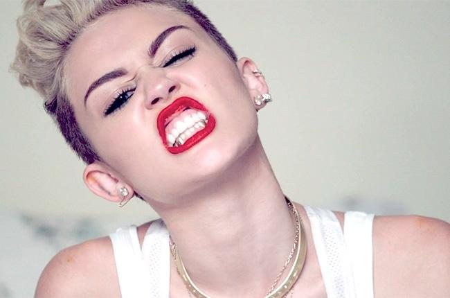 Miley Cyrus bares her teeth at criticism.