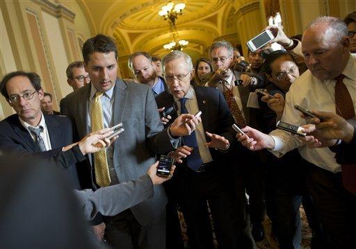 Reporters swarm Senate majority leader Harry Reid (D-NV) during the government shutdown.