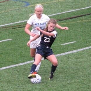 Senior Captain Abbey Smith maintains control of the ball against a Braintree defender.