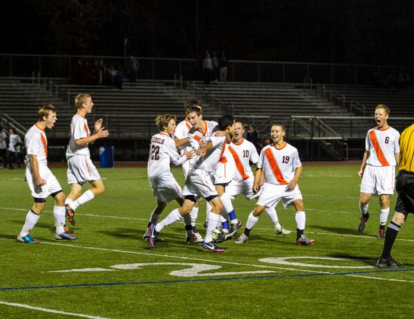 Boys Soccer celebrates after a game.