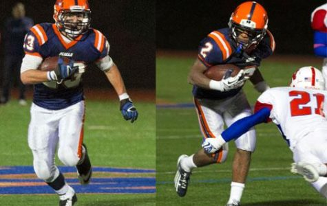 Walpole's sophomore runningback carrying the ball against rival, Natick.