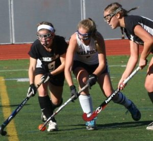 A Walpole player gathers the ball before scoring the game winning goal.