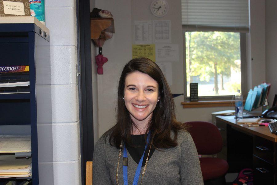Ms. Doran smiles at the camera.