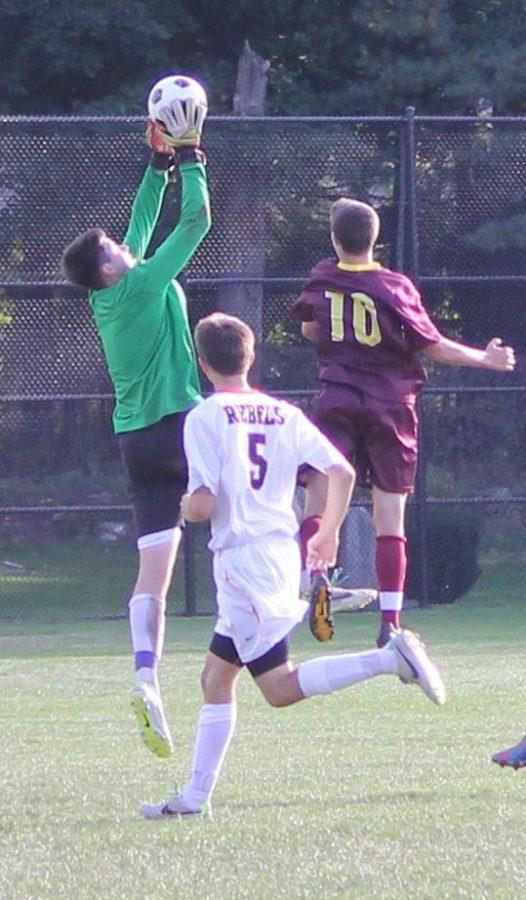 Walpole goalie saves shot.