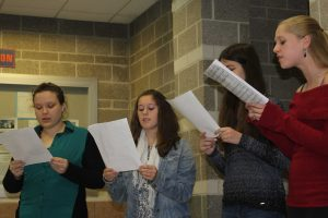 Members of the Altogethers perform carols at Parent-Teacher Conference night