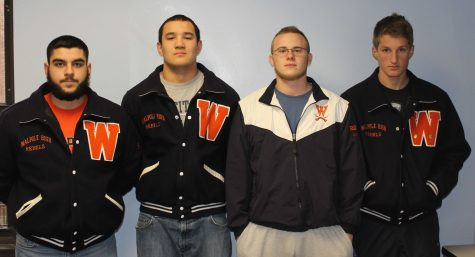 The Wrestling captains pose for a photo.