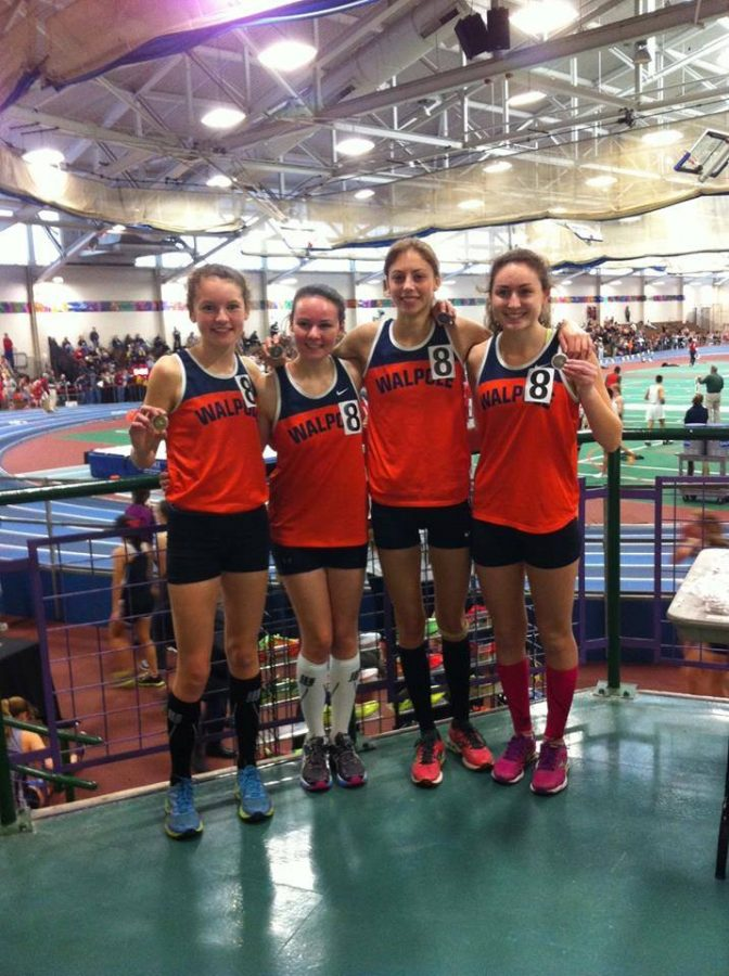 Girls 4x800 meter team poses for a picture after capturing the school record.