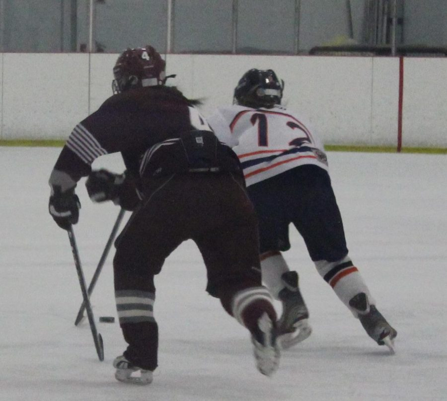 A Rebel attacker skates her way to the first Walpole girl of the night.