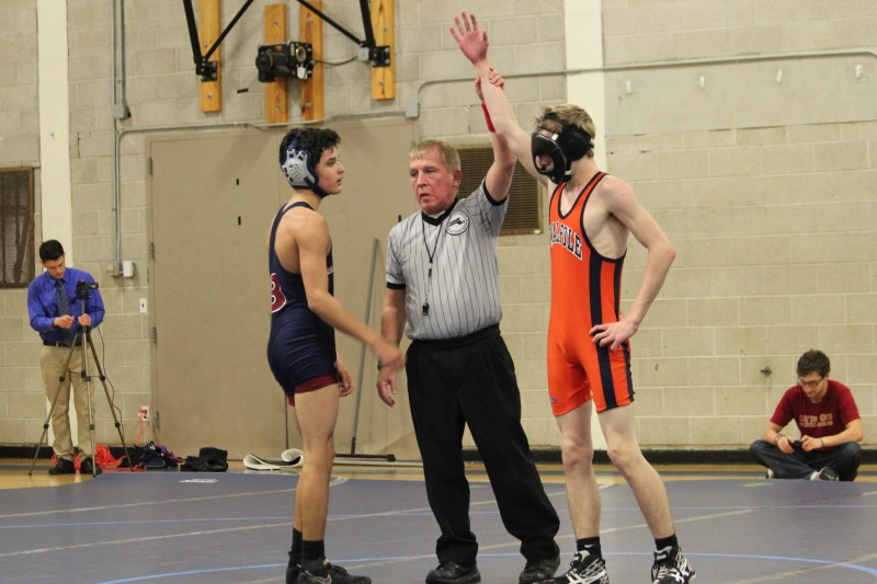 The Rebels's 126 pounder being proclaimed victor against Brookline.