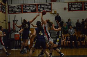 Walpole's center goes up for a shot.