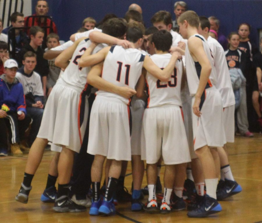 The Rebels come together for their pre-game huddle.