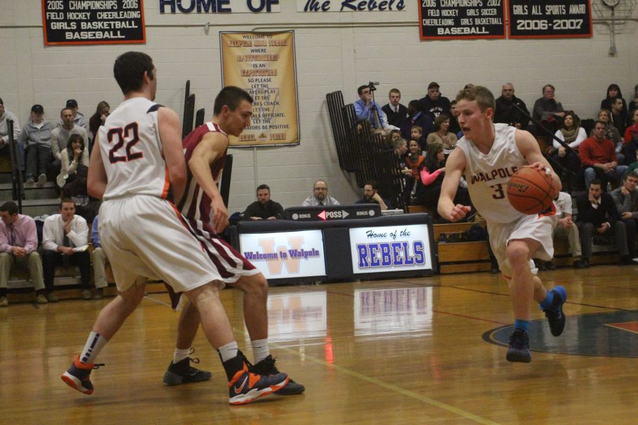 Walpole guard rushes past an opposing defender.