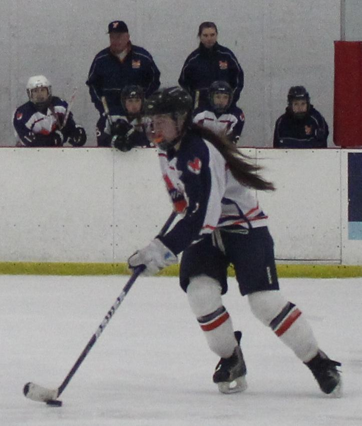 A Rebel brings the puck down the ice.