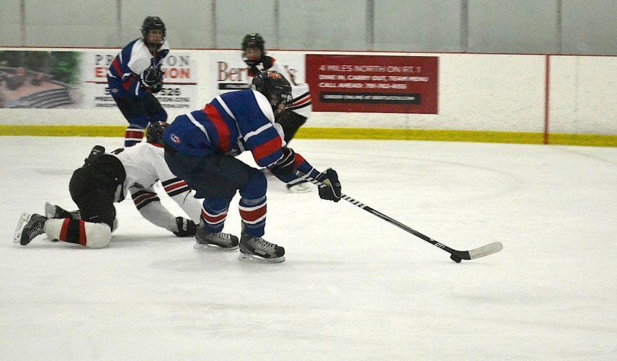 Walpole Senior breaks past a  Wellesley defender.