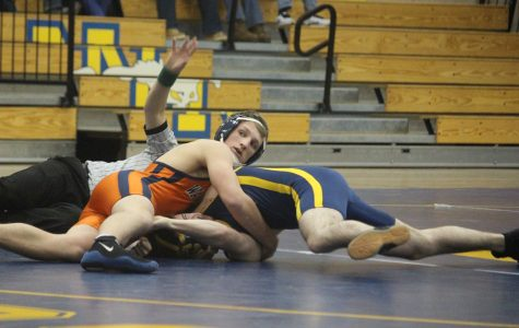 One of the Rebel's senior Captains works to pin his opponent in the 170 pound bout.