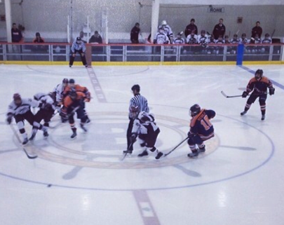 Walpole and Falmouth battle for the puck.