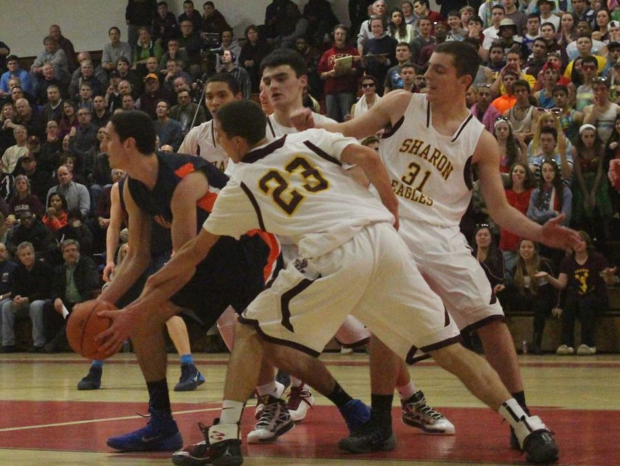 Sharon defenders swarm a Walpole basketball player.  (Photo/ Julia Adams)