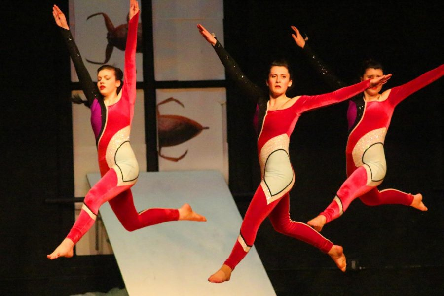 Three dancers perform in the annual Dance Company show.