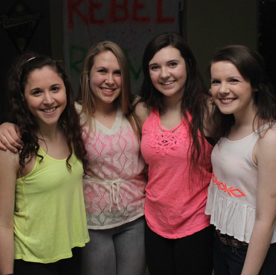 Walpole High School students smile for a picture at the Rebel Rave.