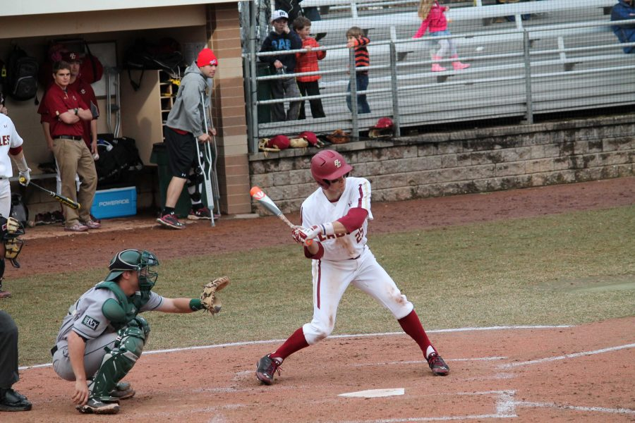 Walpole High School Alumni swings at a ball during a Boston College baseball game.