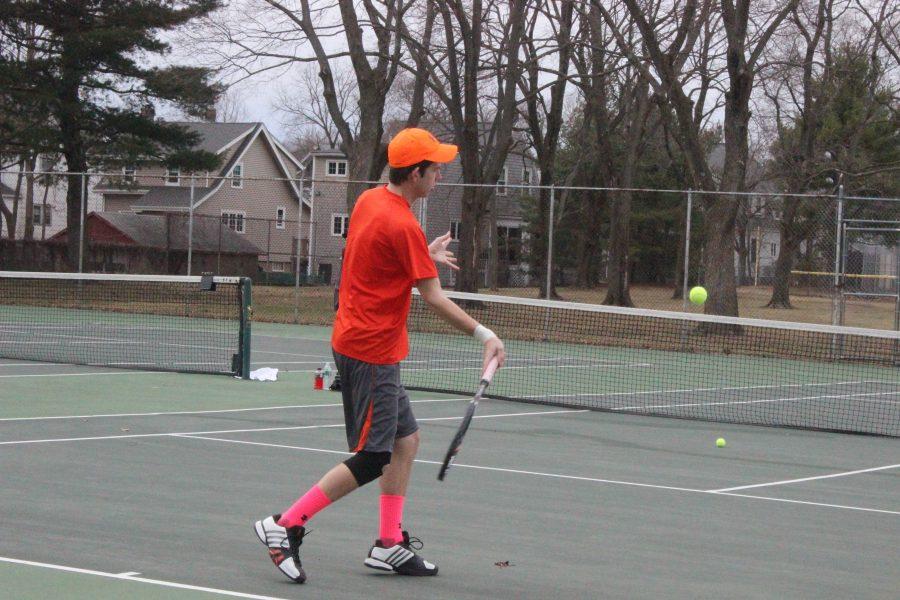 A Walpole tennis player returns a hit.