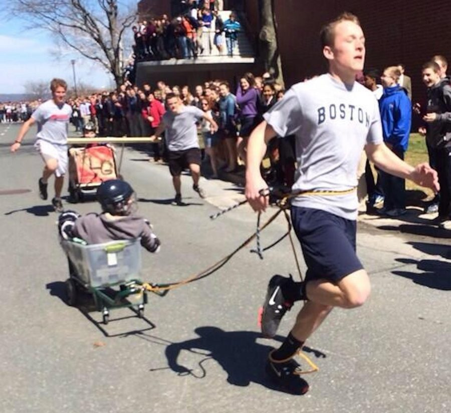 Walpole students compete against St. Sebastian in the chariot races at Holy Cross.