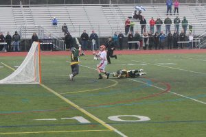 A Walpole attack scores one of his three goals on the day.