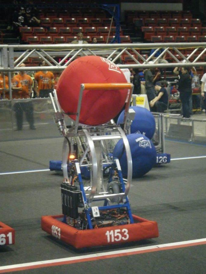 The RoboRebels Prepare their Robot for Battle.