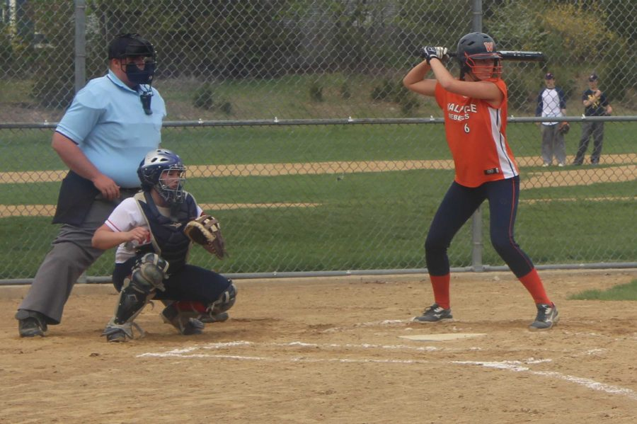 A Walpole  Softball player steps up to the plate.