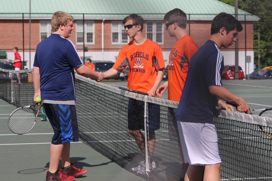 A Walpole student shakes hands with his opposition after the conclusion of the match.