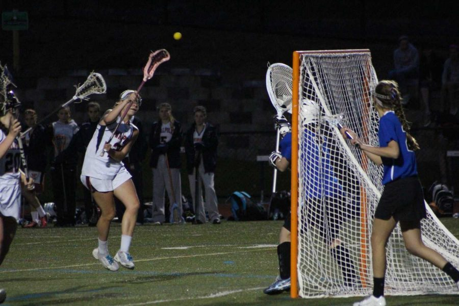A Walpole attackman takes a shot against the Dover-Sherborn goaltender.