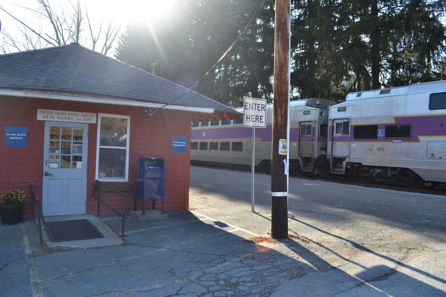 Before the Patriots game on November 23, the event-only MBTA train passes the South Walpole Post Office.