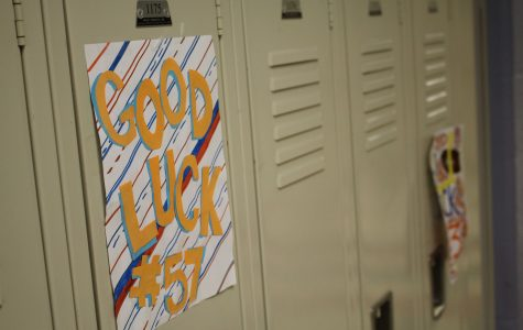Walpole Cheerleaders decorate the Football players lockers with encouraging posters.
